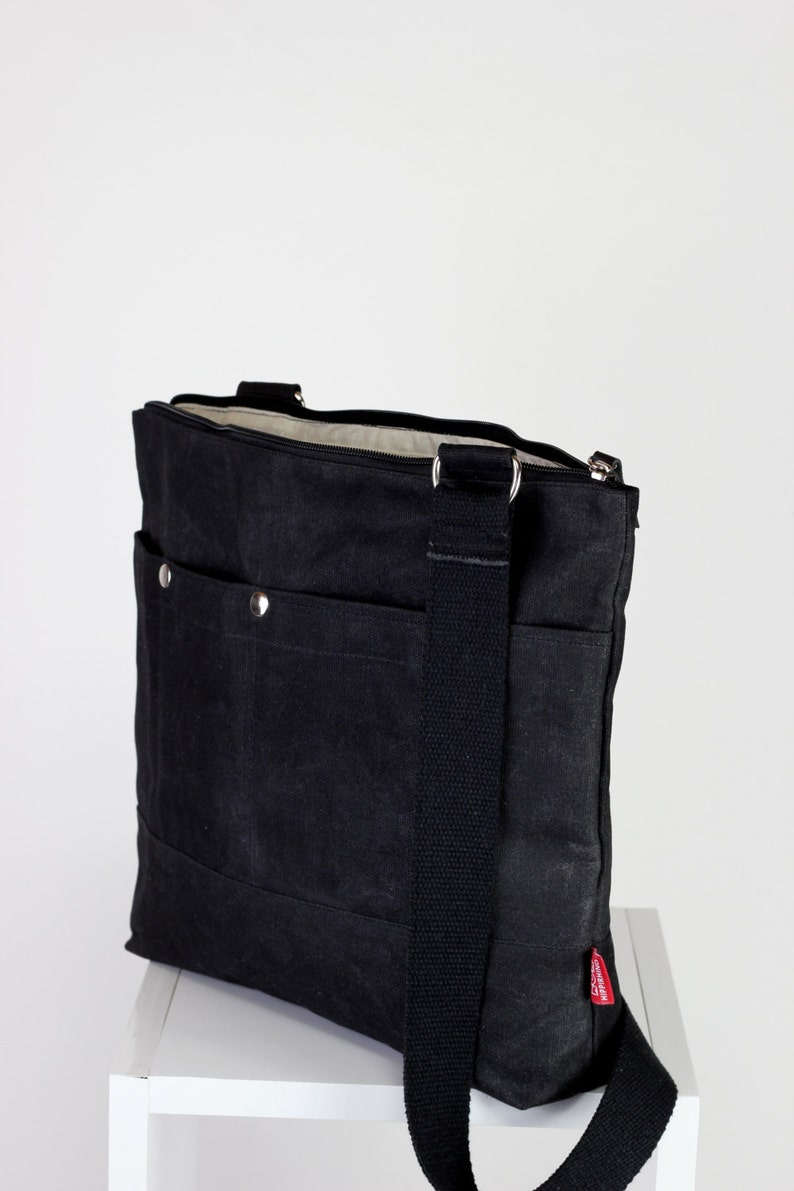f71e4cb0857a Black waxed tote bag cross hang strap pocket on front full