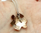 Handmade, copper jigsaw piece, hammered textured finish, swarovski crystal droplet pendant. Quirky, autism awareness on silver chain