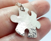 Cute puzzle piece pendant,  chain, sterling silver, hammered finish, shiny, puzzle, jewellery, quirky, autism awareness, jigsaw necklace