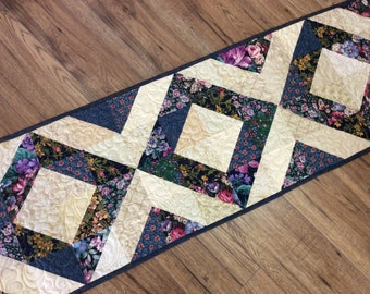 Traditional diamond design scrappy quilted table runner in blue green florals and cream taupe background, floral coffee table topper,