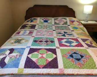 Scrappy sampler quilt in bright spring colours, twin size bed quilt, large colorful lap quilt, feather quilting, sofa quilt, Easter gift