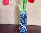 Swirling mosaic flower vase in iridescent purple and blue stained glass