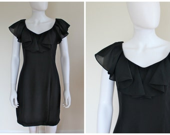 Vintage 1990's Rare Black Ruffle Neckline LBD Goth Grunge Mini Dress By Nanette Lepore Sold From Robespierre NYC Size Vintage 6 Modern 2/4