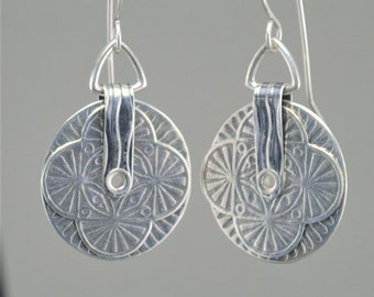 Stacked roller printed silver earrings.