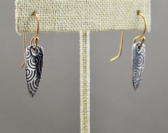 Roller printed sterling silver earrings with 20 gauge 18k earring wires.