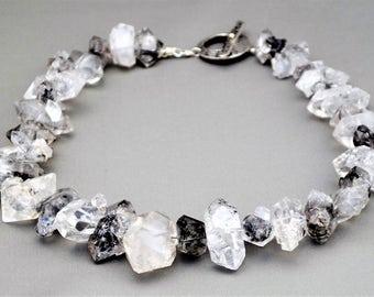 Natural tourmalinated rock crystal quartz necklace.