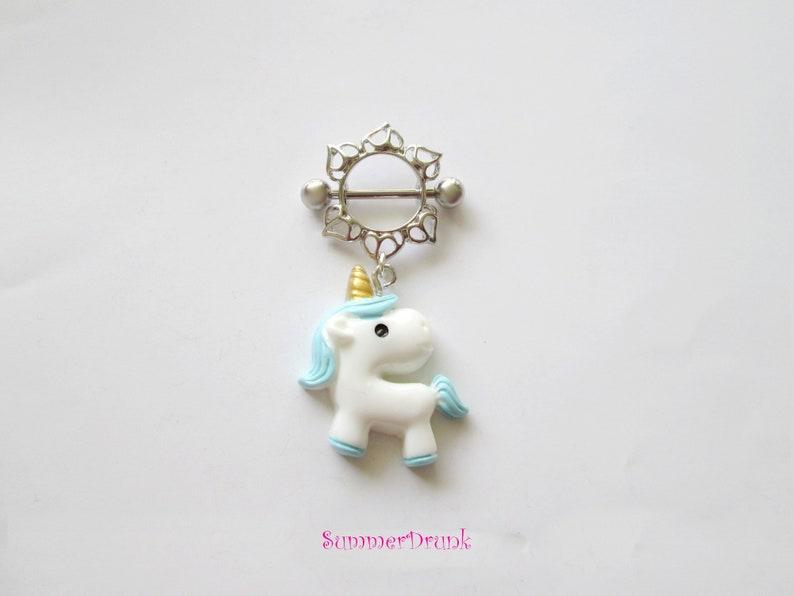 Unicorn nipple ring.