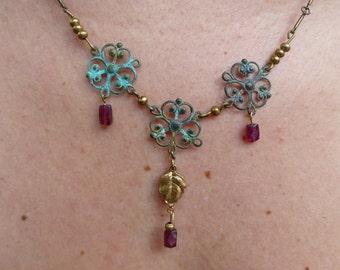 verdigris Garnet pendant and brass