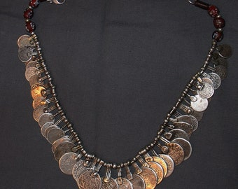 restrung necklace of old maroccan tribal silver coins and red old venitian glass beads