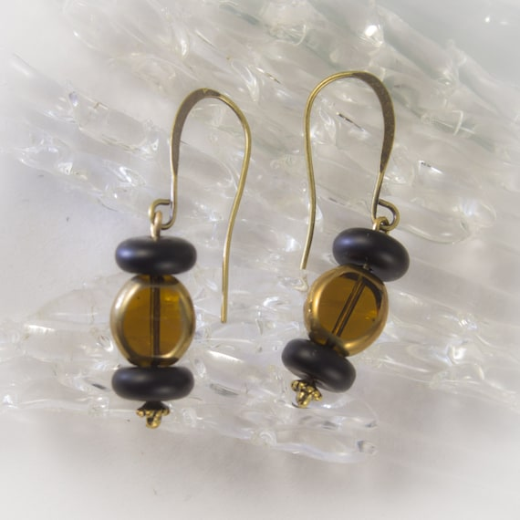 Amber and Onyx drop earrings on antique brass french hooks