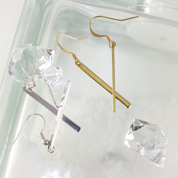Silver Rhodium or Gold Plated vertical bar drop earrings.