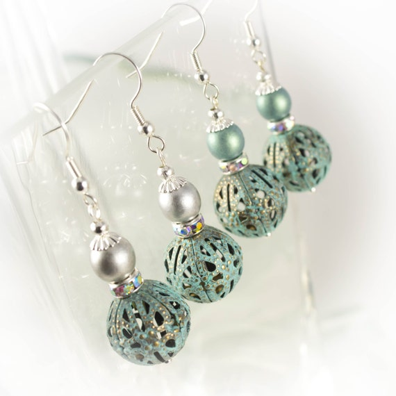 Patina metal filigree drop earrings with suede satin pearls in two colour choices