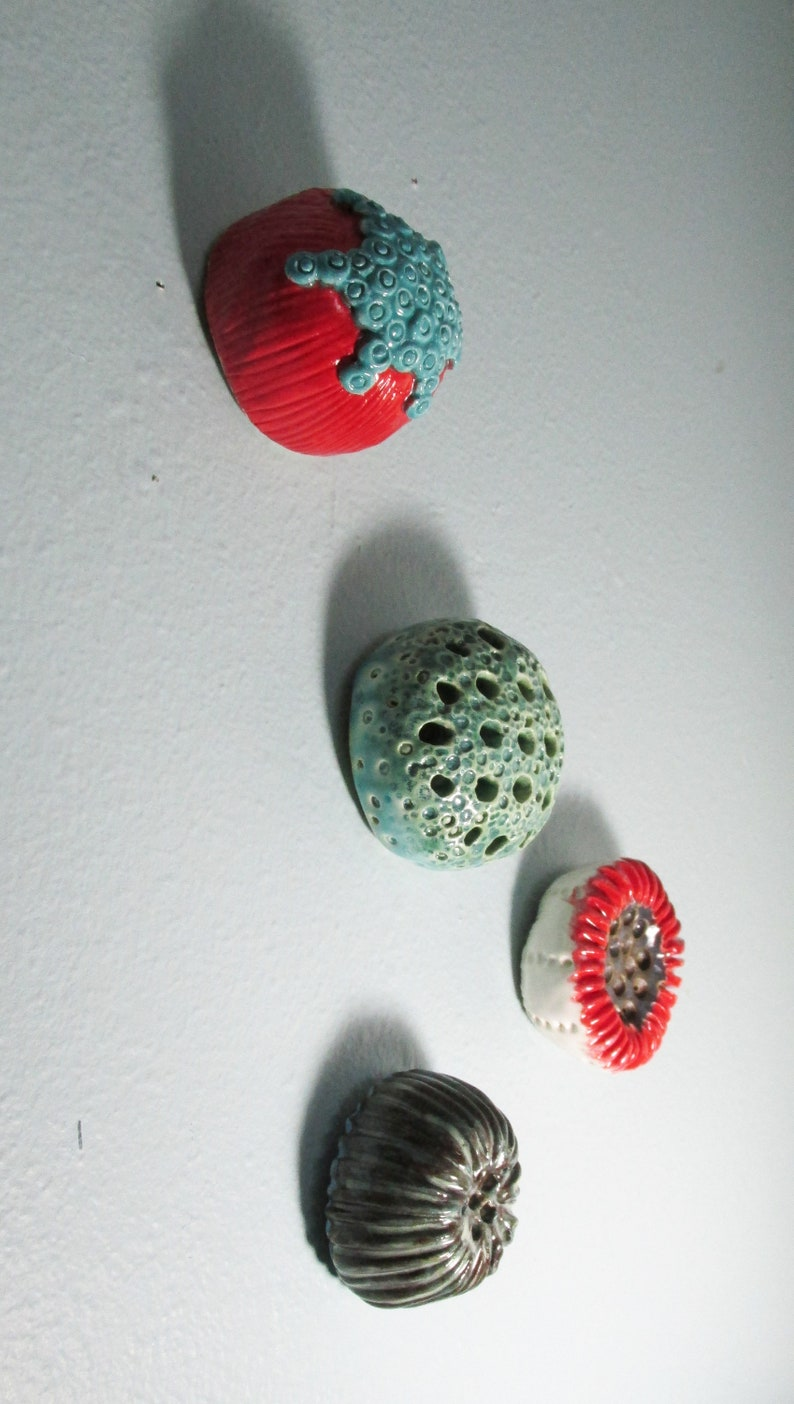 Ceramic fired organic wall piece or paperweight textured I call blueberry and cherries