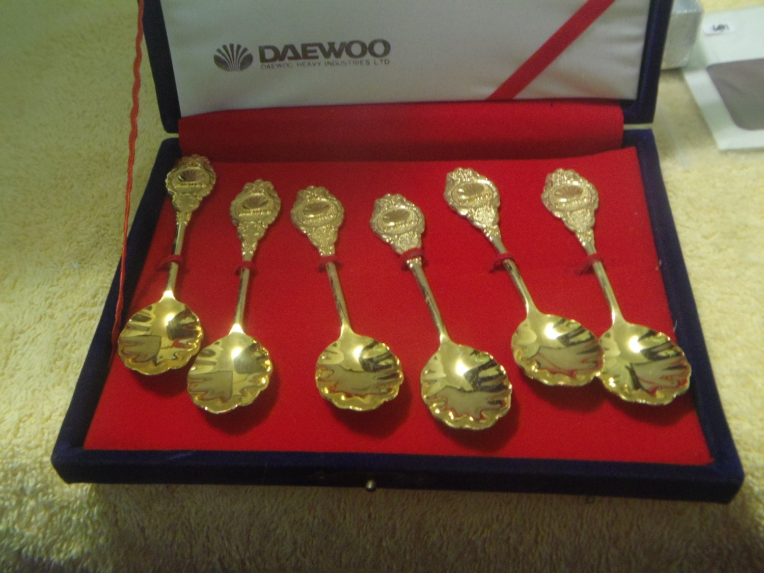 Vintage Daewoo Heavy Industries Gold Tone Collectible Spoon Set