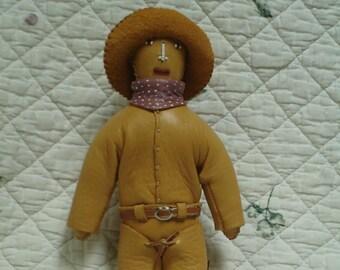 Buckskin cowboy doll named Bud