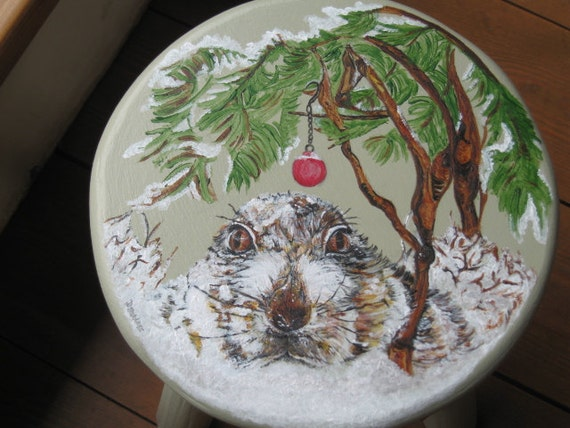 Milking stool with a painting of a pet rabbit in snow at Christmas time!
