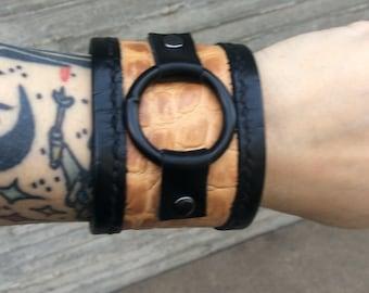 tan black embossed leather cuff