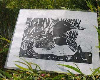 Common Loon by lake linoleum block print