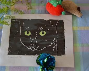 Hand tinted linoleum print of a black cat