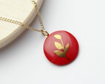 Red porcelain pendant, with gold leaf.