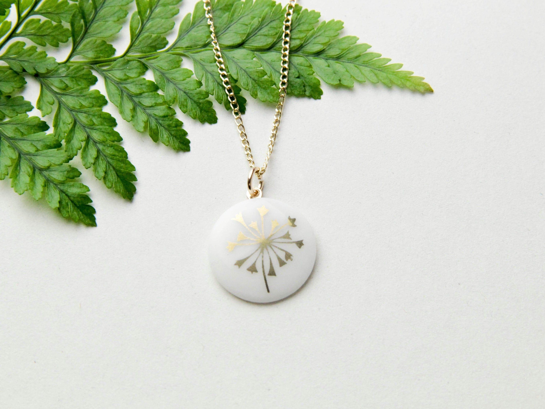 with golden decor. Snow-white porcelain pendant
