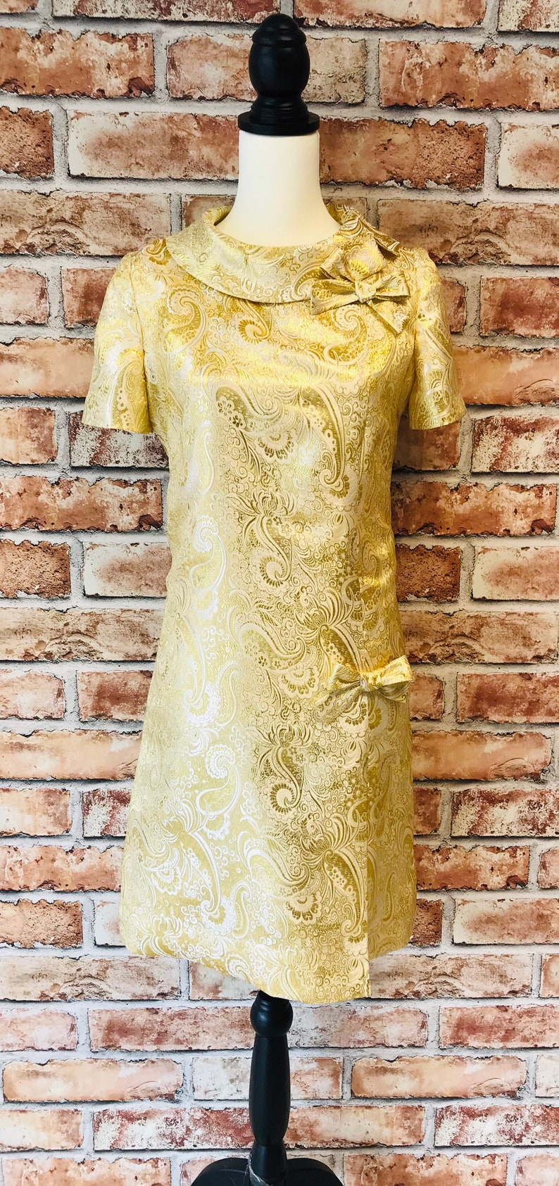 60s Dresses | 1960s Dresses Mod, Mini, Hippie Mod Dress Classic 1960s Style Gold paisley $146.00 AT vintagedancer.com