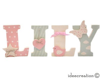 Letters to pose, wooden first names and printed fabrics personalized with the child's first name, model Rose, beige and light green