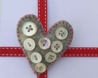 Heart shaped brooch with mother of pearl buttons