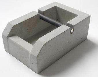 raw living knockbox made of concrete, espresso