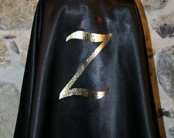 Drawing black satin Cape shape gold Z: 6 years