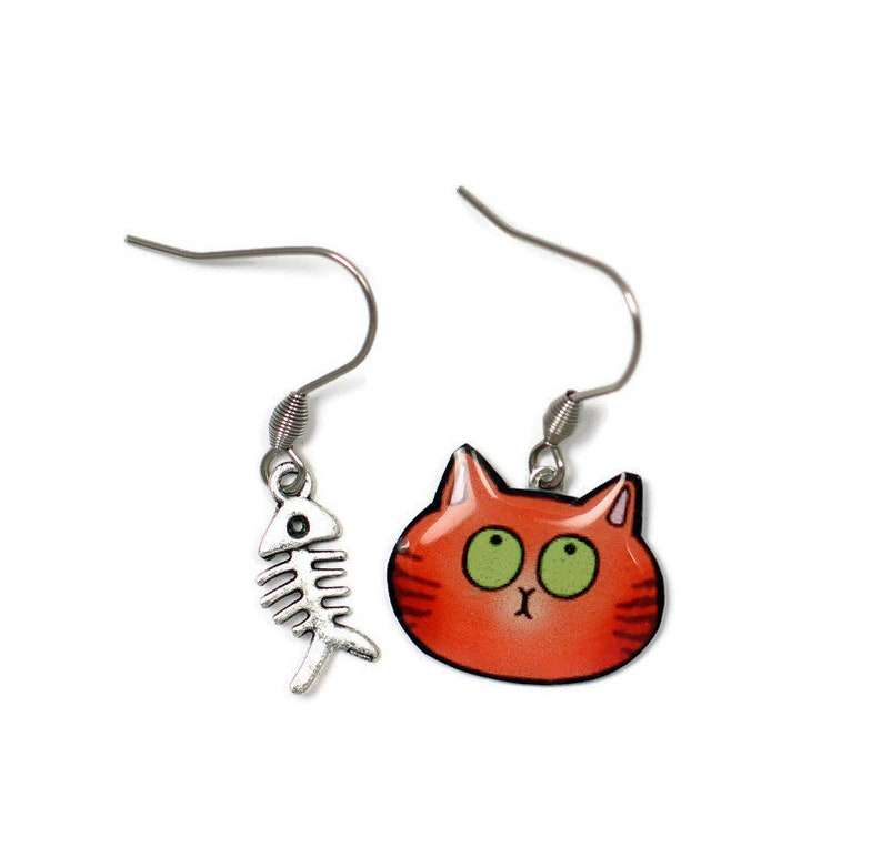 Mismatched red cat earrings and fishbone image 0