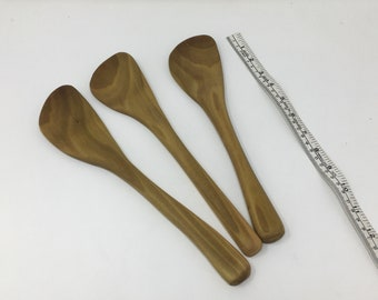 Hand carved wooden curved spatula.