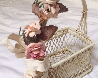 Ivory basket with pink flowers