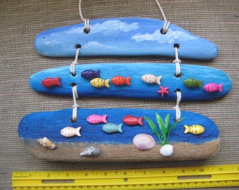 Driftwood hanging wall art hand painted with fish in ocean scene