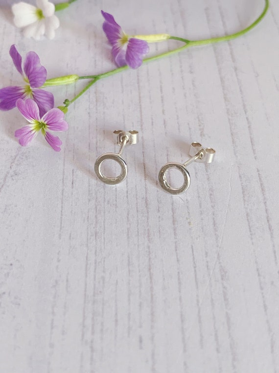 Recycled sterling silver tiny hoop stud earrings. Hammered texture, minimal style.