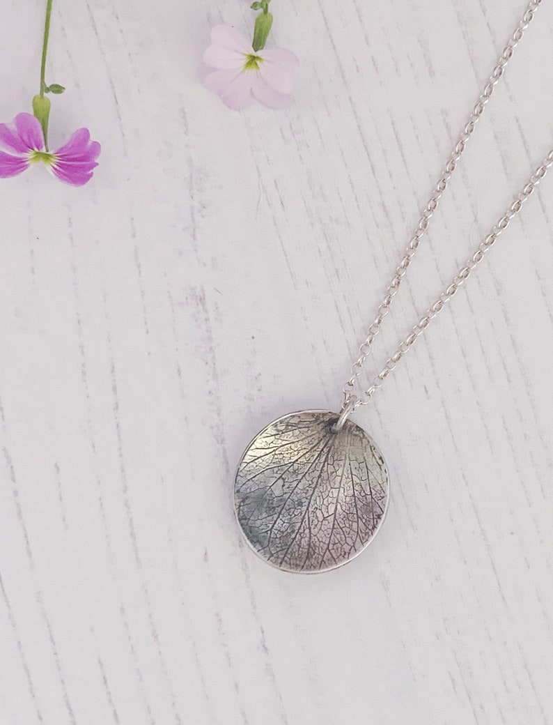 Sterling silver petal necklace oval domed disc with oxidised image 0