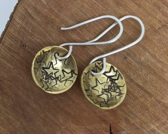 Cute silver and brass star dangly earrings, stamped and domed brass disc, rustic, goth, boho, gift for her