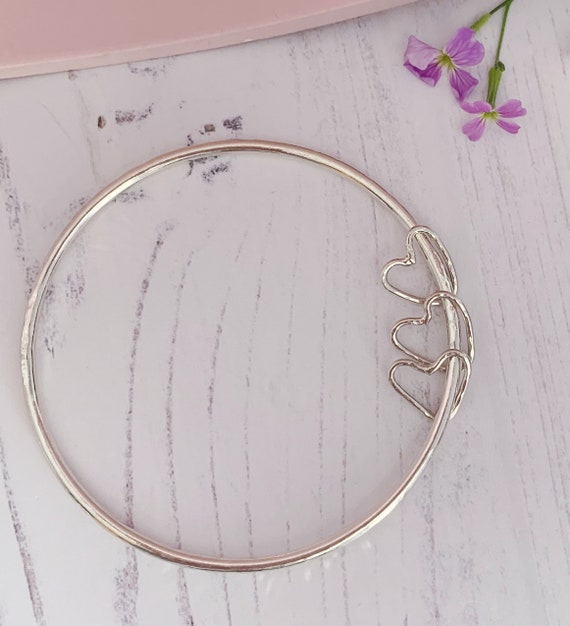 Recycled sterling silver bangle with 3 heart charms. 2.5mm thick hammered bangle, valentines.