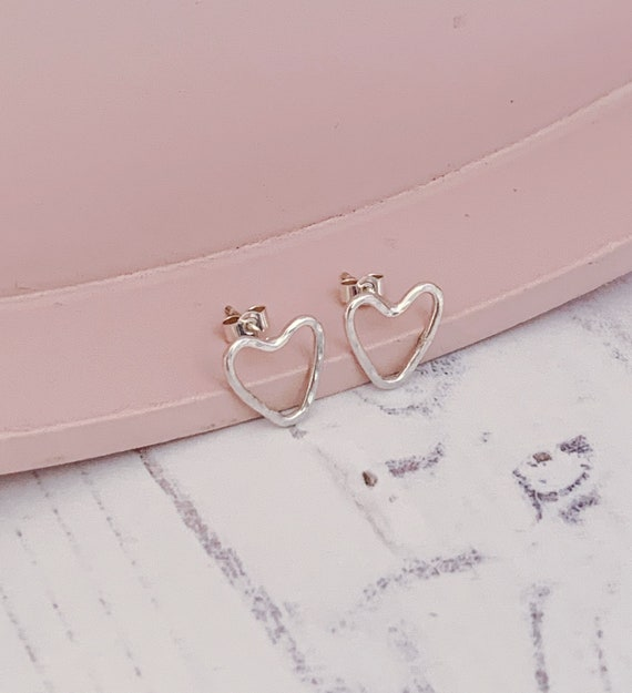 Minimal style sterling silver heart outline stud earrings. Hammered texture, recycled eco silver. Unique one of a kind.