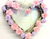 Pink and purple flower wicker heart wreath for door or wall decoration with ribbon for hanging