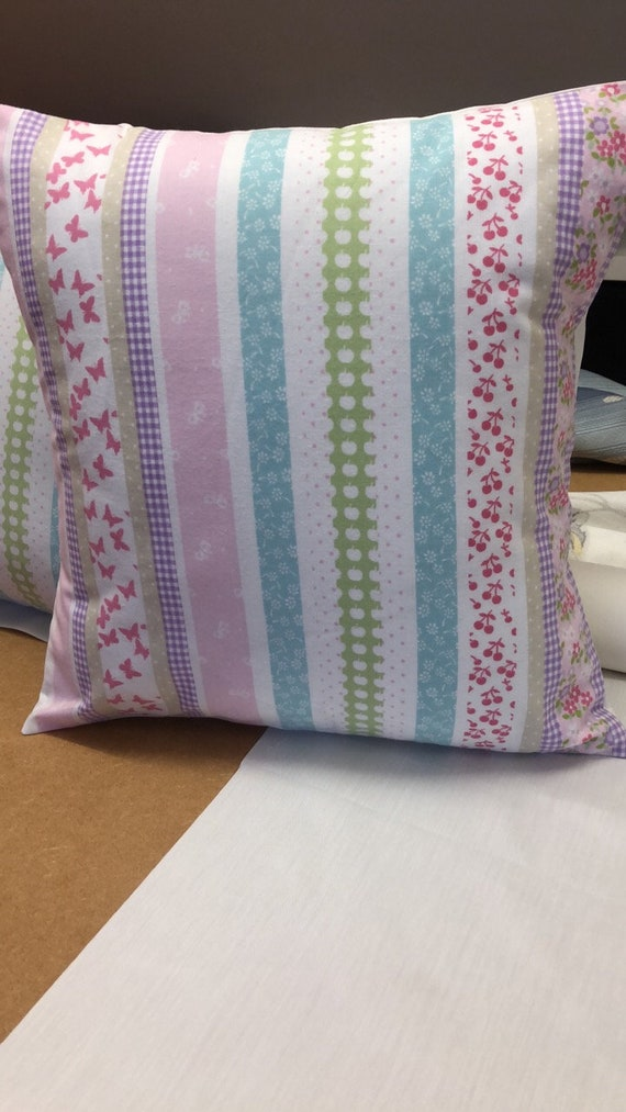 TWO LAURA ASHLEY HANDMADE CUSHIONS IN WILD MEADOW MULTI COLOURS FABRIC