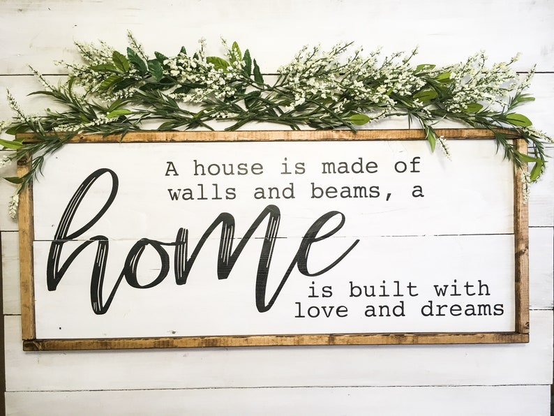 A House is made of bricks and beams A Home is made of love and dreams wood sign