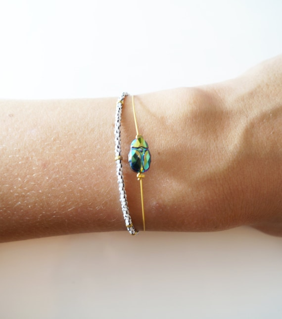 Thin bracelet Swarovski metallic scarab bead silver and gold   Etsy e639b59149