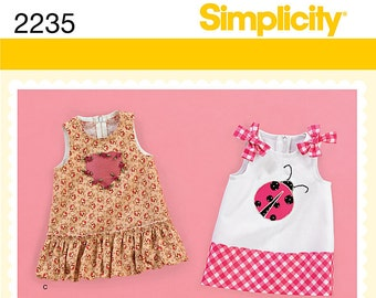 SIMPLICITY 2235 Babies dress. Size XXS-L. Pattern is new and uncut.