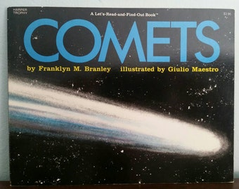 Comets by Franklyn M Branley, illustrated by Giulio Maestro, vintage paperback children's science book