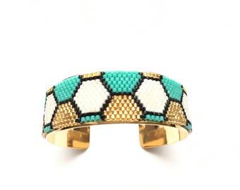 Very nice bracelet black and white, Teal and gold woven miyuki mounted on rigid bracelet