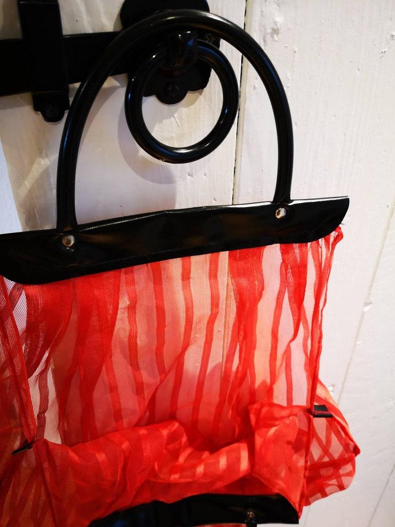 Original 1960s sheer nylon shopping bag red with black plastic handles vintage. hippy