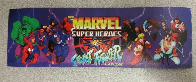 Buy any 3 of my stickers, GET ONE FREE! Marvel Vs Street Fighter marquee sticker.