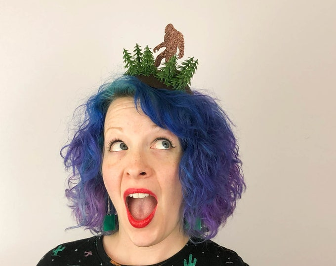 Featured listing image: Bigfoot in the Forest Fascinator, Sasquatch Sighting