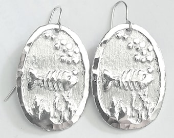 Earrings for summer, lightweight, made of aluminum with a silver hook and an engraved fish.